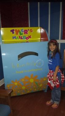 Beside the mailbox for children's letters to God, GKTW Village