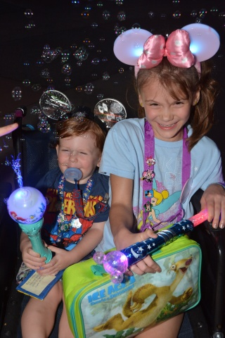 Mercy and Pierson with their Star Wars & Minnie Mouse, interactive, light up ears, and toys.