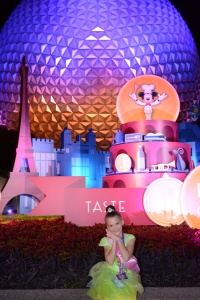 M infront of Night Epcot ball