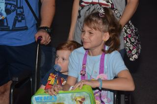 Mercy crying as she realizes she and Pierson are going to be gifted toys from Mickey Mouse.