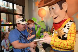 Pierson getting Woody's autograph from the safety of Daddy's arms